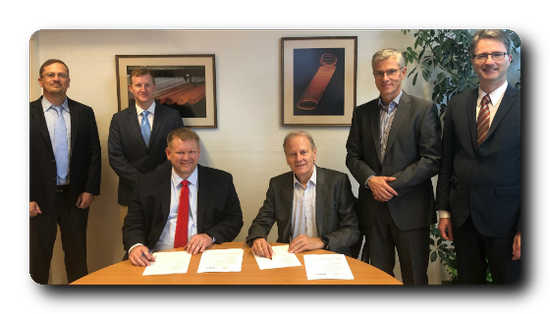 At the signing ceremony in Hamburg (from left to right): Vincent Chevrier, Todd Astoria and KC Woody from Midrex with Dominique Vacher, Dr Uwe Braun and Matthias Schad from ArcelorMittal.
